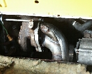 steel plate with wastegate, primary outlet and heat shield